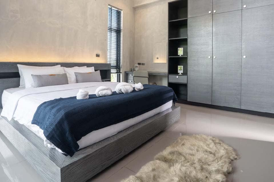 spacious modern loft bedroom with blue bed liner